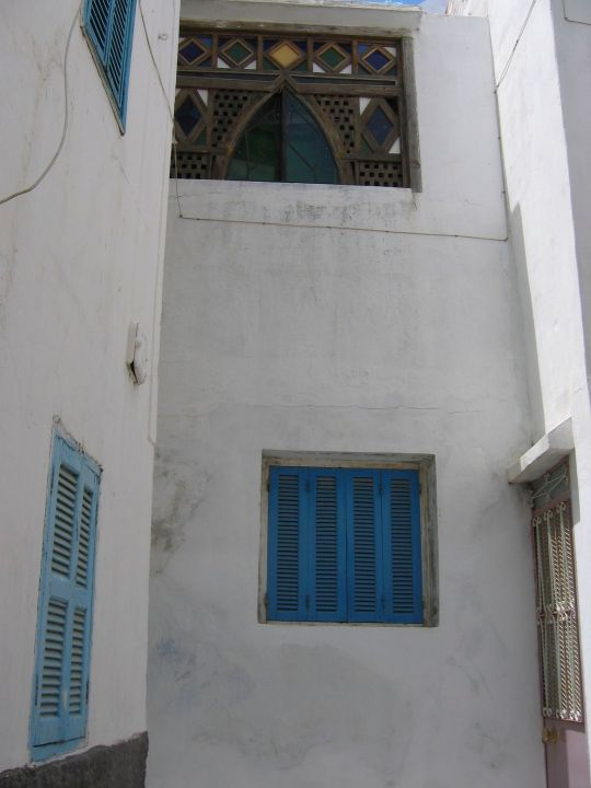 Blue shutters and stained glass